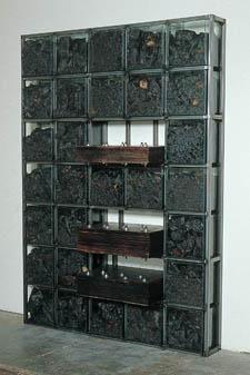 Chen Zhen, Bibliothèque, 1992, burnt newspapers, glass, paper, cm 216 x 155 x 40.