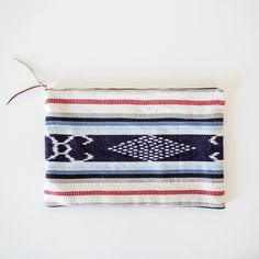 Small enough to go everywhere with you and big enough to fit everything you need inside. Handwoven cotton. Brass zipper. Genuine leather tab. 13x8.5. Handmade with love in Guatemala.