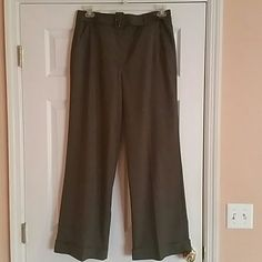 Dressy pants Good dressy pants with same material belt, wide legs. In excellent condition. Color is dark gray and material has some stretch to  it. This pants make you  look fabulous. Larry Levine Pants Boot Cut & Flare