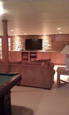 Turned an unused basement into an entertaining space. Detail of stacked stone and down lighting