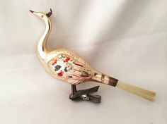 $68 - 1920s Antique PEACOCK CLIP On BIRD Christmas Ornaments Germany, Pink Silver Glass Bird Clip Ornament, Vintage German Blown Glass Ornaments . . . By JustVintageChristmas . . . Lovely and delicate antique German pink glass peacock clip on bird ornament, in wonderful condition. It is a large size bird at 5 inches wide, complete with its original spun glass tail feathers and wonderful antique spring clip! Circa 1920s-1930s.