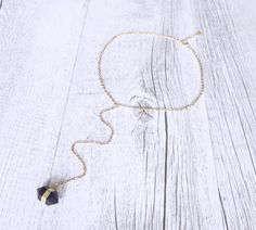 This beautiful Y necklace is made from a stunning amethyst gemstone suspended from a 24k gold plated chain.  Amethyst is said to aid creative