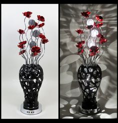 http://www.wirelamps.co.uk/WLT2025-5red.html  Height 90cm Width 25cm Depth 25cm  Black Ceramic Vase Wire Lamp - Vase featured Styled Hole Design to create a unique shadow Pattern.  Emerging from the vase are riveted silver stems featuring bloomed red flower heads