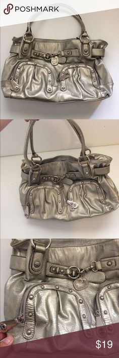 "Kathy Van Zeeland Silver Tote Bag with Pockets Silver metallic Vegan Leather Kathy Van Zeeland Collection Bag. Exterior in good condition, lining has some issues with wear and staining. All reasonable offers accepted. 16"" by 9"" Kathy Van Zeeland Bags Totes"