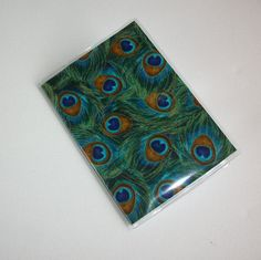 Passport Cover / Holder / Case   Peacock plume by Laa766 on Etsy, $6.50  These are great for identifying your passport quickly in your purse or suitcase... buy a couple so you can easily identify each family members passport.