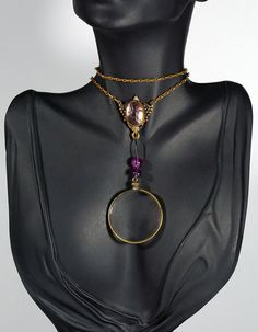 In #CherryOrchardAttic on #Etsy  Victorian Art Nouveau Style Magnifying Glass Monocle Amethyst Lariat Necklace #MagnifyingGlassNecklace #MonocleNecklace #AntiqueNecklace #VintageNecklace #VictorianNecklace #LongNecklace #Magnifier #LariatNecklace #ArtNouveauNecklace #jewelryblogger #MagnifyingGlass #MagnifyingGlassPendant #AntiqueLook #SteampunkNecklace
