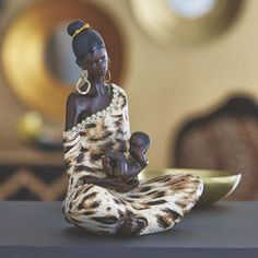 Woman and Baby Figurine from Midnight Velvet.  A tender moment frozen in time, this figurine shows the bond between mother and child.