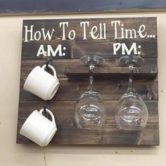 """How to tell time AM vs PM"" kitchen wall decor.  Cute idea to store mugs and wine glasses."