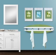 """A coordinated set of surf theme framed prints and a surfboard coat rack will complete your kid's room surfer dude decor! De-clutter and bring surfer style to your kid's room with this 5 hook handmade surfboard coat rack and set of three surf themed printswith a piece of surfer inspired wisdom: """"Live Life One Wave at a Time"""", """"Smooth Sailing"""" and """"Swim with the Sharks""""."""