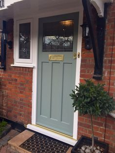 1930 s style Timber Entrance Door painted Farrow and Ball Castle Grey and fitted with Brass Samuel Heath Ironmongery Cottage Front Doors, Front Door Porch, Grey Front Doors, Front Door Entrance, House Front Door, Painted Front Doors, Glass Front Door, Entrance Ideas, Door Ideas