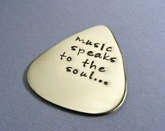 Sapphire9Jewelry Etsy Shop: Personalized guitar pick $18... Personalized with name, quote, etc. I think a guy would appreciate this useful gift no?