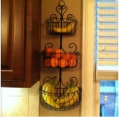Organizational Tips. Garden planter for the wall holds items off of the counter