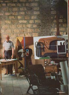 Le Corbusier in a bowtie in his studio