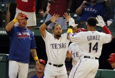 Jeff Banister and Rougned Odor celebrate with Carlos Gomez after Gomez and…
