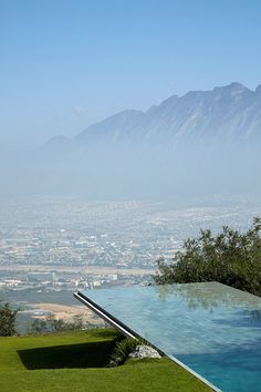 Awesome location for a zero edge pool.  Infinity pool with Indonesian granite tiles, House in Monterrey by Tadao Ando