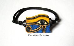 Adjustable Bracelet created with polymer clay, represent the Eye of Ra (Horus). This creation, as all my creations, is reproducible and can be modified to your liking.  size 1,2 x 0,8 inches  You can ask me a personalized creation: you can tell me the aspects that you want modify (colors, size..) and send me also a photo to help me understand, Ill make yours desired object with much pleasure! In the case this object is too different from other creations on my shop I create for you a…
