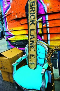Some bright street art and a cool vintage chair at the Brick Lane Market.