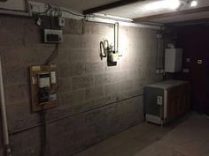 Before cabinets were started. Showing the meters, boiler and white goods to be incorporated