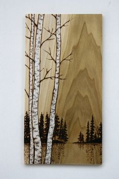 These beautiful birch trees have been burnt into a thin piece of poplar wood and finished with a touch of whitewash and oil to enhance the birch