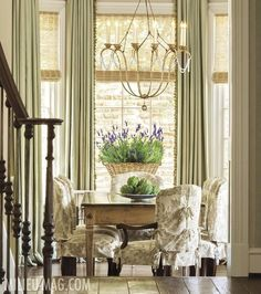 drapery panels with roman shades/chandelier