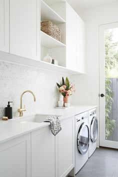 Gorgeous Laundry Room with Marble Penny Tile Backsplash, White Cabinets and Gray Tile Floors / Adore Home Magazine room cabinets above washer LITTLE WILLOW — Adore Home Magazine White Laundry Rooms, Modern Laundry Rooms, Laundry Room Layouts, Farmhouse Laundry Room, Modern White Bathroom, Laundry Decor, Laundry Room Organization, Laundry Room Design, Laundry In Bathroom