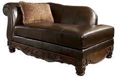 The North Shore - Dark Brown Chaise from Ashley Furniture HomeStore (AFHS.com). All leather upholstery in North Shore leather, featuring the luxurious look and feel of top quality leather, offered with some protection.