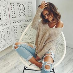 ripped jeans and tan sweater