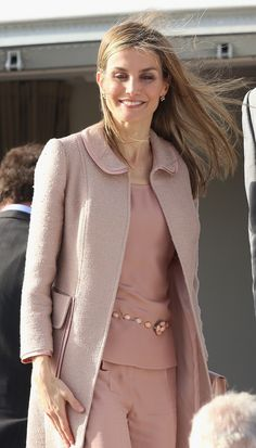 Queen Letizia of Spain waves goodbye as they depart Rabat Airport after a two day visit on July 15, 2014 in Rabat, Morocco. The new King and Queen of Spain are on a two day visit to Morocco.