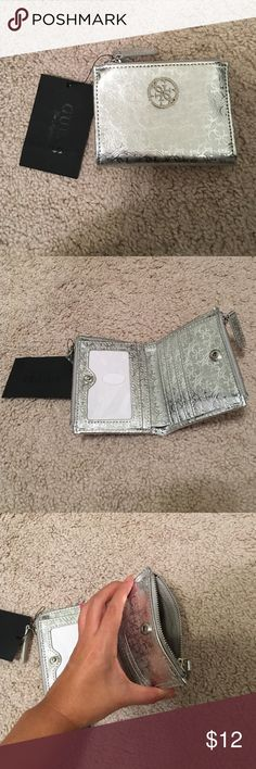 New with tags Guess wallet New with tags Guess wallet. Never been used. Received as a gift and never used. Lots of pockets for a small wallet. 6 card slots with clear pocket for ID. Two zipper pockets on each side for coins. Big slot for bills. Great travel wallet or small wallet for small purses ❤️ GUESS Bags Wallets