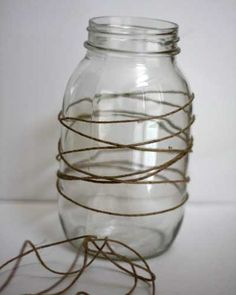 DIY Halloween Decorations - Mason Jar Luminaries  Spray paint this with flat black or ivory paint & remove the twine.  Voila, you have a simply beautiful votive.