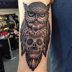 Owl and skull forearm tattoo