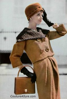 Rose Marie is wearing a brown wool suit with a fur scarf and hat by Pierre Cardin.