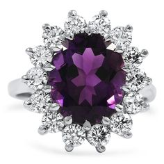 Oval-shaped amethyst ring surrounded by diamonds.