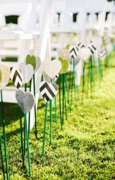 Alternative to florals in aisle, use heart cut outs in silver, white, and royal blue! Hang from ribbon?