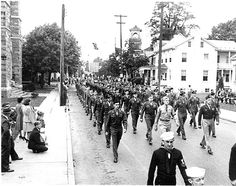One of our most famous photos. Parade for returning veterans after World War Two in 1946.  This one is the source for the mural on the wall of the South Queen Street branch of Metro Bank. This was taken from in front of Eberly's Funeral Home looking west on Main Street.
