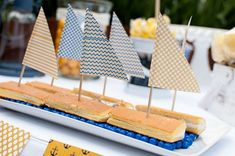 Edible sailboats at a nautical baby shower party! See more party planning ideas at CatchMyParty.com!