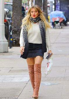 Strut! The 29-year-old actress paired her look with a white sweater and ombre-colored scar...