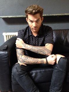 "#adamlambert, w/ fantastic arm tattoos, just told me he won't tour til 2016 bit luvs his ""sweet"" #canadian #glamberts"