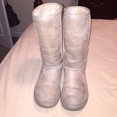 Tall Ugg Boots Call Tall Ugg Boot in the color sand. Worn a couple and they do have a slight stain in the back of them (due to my blue colored jeans) and also have a crease in the front of them. I do also have the ugg sheepskin care kit to clean the uggs which I will give for free with the shoes if purchased. UGG Shoes