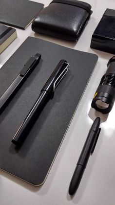 my black stuff. moleskine notebook, lammy safari, scrikss trio, fisher space pen, moleskine click pen.