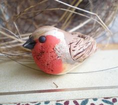 from http://www.etsy.com/listing/110762806/european-robin-polymer-clay-bird-bead?