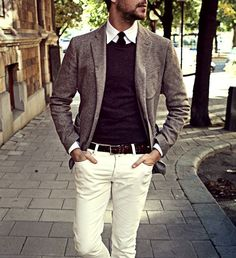 Shop this look for $244:  http://lookastic.com/men/looks/crew-neck-sweater-and-blazer-and-tie-and-belt-and-chinos-and-dress-shirt/1417  — Violet Crew-neck Sweater  — Grey Wool Blazer  — Black Tie  — Brown Woven Leather Belt  — White Chinos  — White Dress Shirt