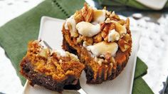 Crushed gingersnap cookies are the base for these mini muffin tin pumpkin pies. Finish by topping them with toasted marshmallows and pecans.