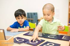 "A Montessori Class At Kidz Venture  Children working with the sand paper numerals - a special piece of material that gives them the ""Muscular Memory"" of the numerals."