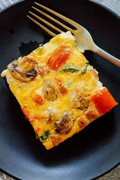 A slice of baked denver omelet breakfast casserole on a plate