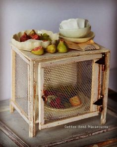 """432 Likes, 12 Comments - Cecilia (@coffee.seed.miniatures) on Instagram: """"Garde-manger in 1:12, made with balsa and tulle, hinges made with tea light aluminium. Food and…"""" #miniaturefood #miniaturefruit"""