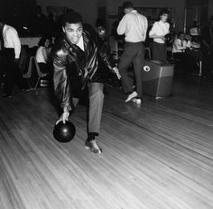Boxing champ Muhammad Ali lets loose at a bowling alley in Chicago, IL in 1965 (Isaac Sutton/Ebony Collection) Muhammad Ali from the EBONY Archives