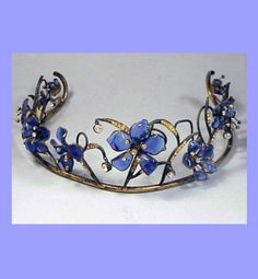 A vintage Gripoix Tiara, 1930s. Blue pâte de verre flowers set on gilt-metal…