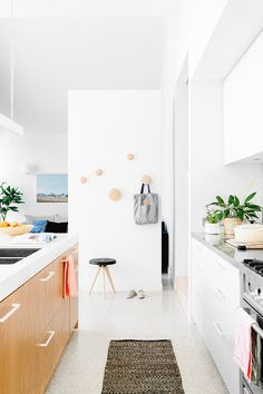 KitchenPolished aggregate floors and the Caesarstone-topped island are examples of the clean tones seen throughout...
