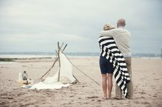 Couple Looking at Tent on the Beach